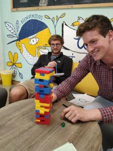 Student is playing jenga at Whee institute Spanish School in Bogota Colombia